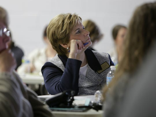 Barb Beaulieu, a human development extension specialist for Purdue University, listens Tuesday, May 19, during a forum on Tippecanoe County youth and gang activity at the Bauer Family Resources community center, 330 Fountain St. in Lafayette.