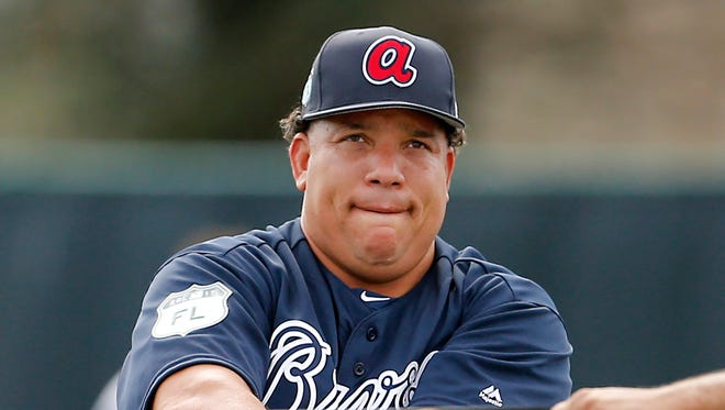 Atlanta Braves starting pitcher Bartolo Colon (40) stretches his arms during MLB spring training workouts at Champion Stadium.