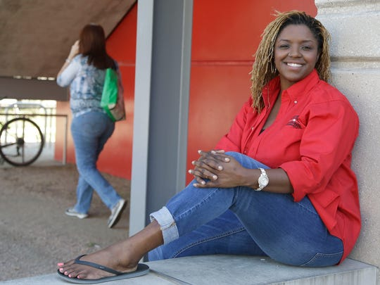 "In this Oct. 5, 2015, file photo, Roni Dean-Burren poses on the campus at the University of Houston, in Houston. Dean-Burren asked publisher McGraw-Hill Education to change the text in a geography book that refers to slaves as ""workers."""