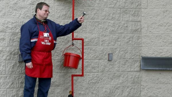 A Salvation Army bell ringer takes donations at the Marsh on Tillotson Avenue in this file photo.