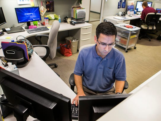Rob Kalesse works at his desk at Corporation Service