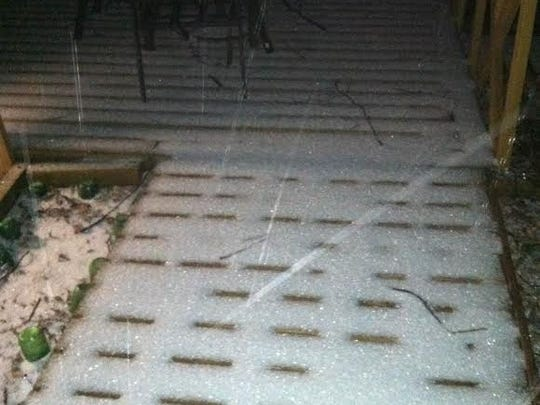 Ice coating a deck in Candler.