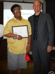 Jacob Johnson accepts his 'Be A #ModelMan' Certificate