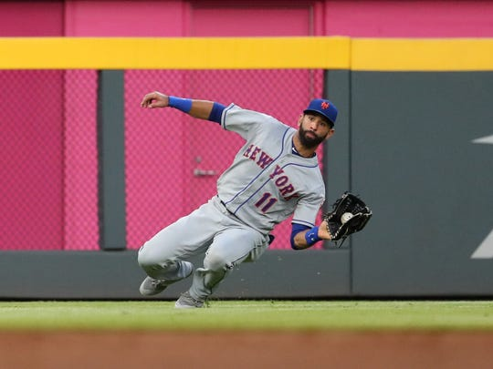New York Mets left fielder Jose Bautista (11) makes a diving catch to get out Atlanta Braves second baseman Ozzie Albies (1) during the third inning at SunTrust Park.