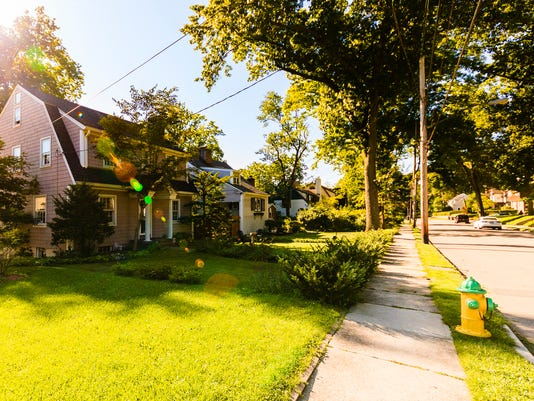 Residential street in New Rochelle, Westchester, at beautiful sunny day