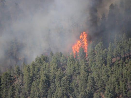 A fire burning on the Arizona Strip burns at the size