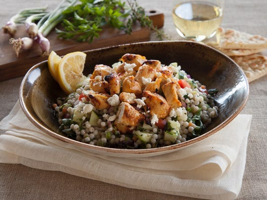 The Luna Grill menu includes dishes like Mediterranean Chicken Salad, featuring feta cheese and Israeli couscous. The chain is opening locations this month in Oxnard and Ventura.