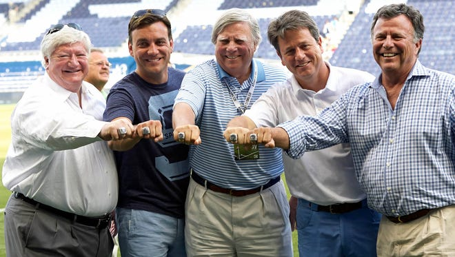 From left Sporting KC owners Cliff Illig, former Sioux Falls Skyforce co-owner Robb Heineman, Pat Curran, Greg Maday and Neal Patterson pose with their championship rings after the game against Columbus Crew at Sporting Park.