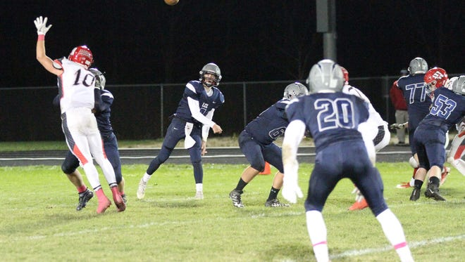 Lake Country Lutheran quarterback Ethan Wilkins targets Michael Schumacher (20) during the game against Westby in Level 2 of the WIAA Division 5 playoffs Oct. 27.