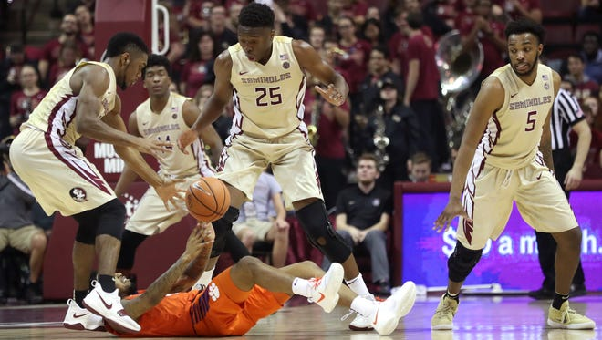 FSU's Trent Forrest, from left, Mfiondu Kabengele, and PJ Savoy watch a loose ball against Clemson during their game at the Tucker Civic Center on Wednesday, Feb. 14, 2018. .