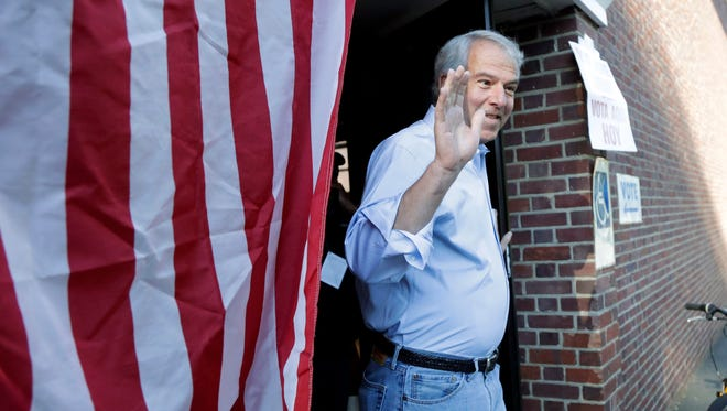 Bob Hugin, a Republican candidate running for U.S. Senate in New Jersey, gestures while exiting his polling place after casting his vote in the Republican primary on June 5 in Summit.