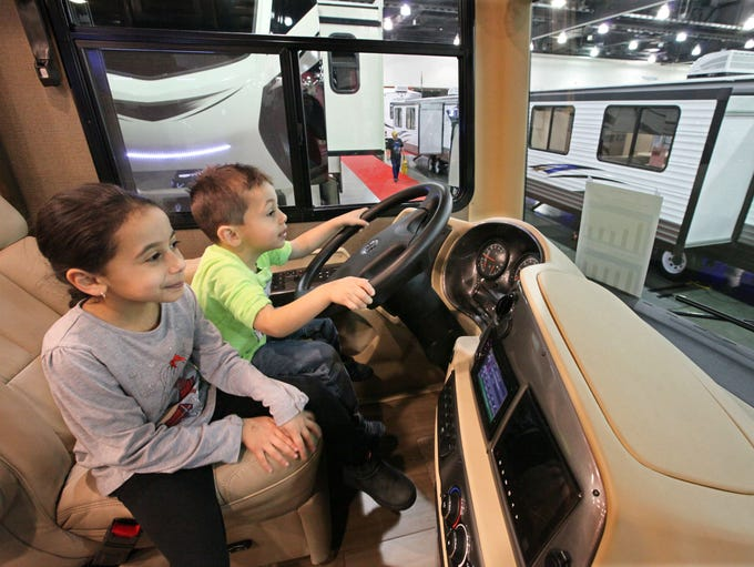 Layth Zee, 4, of Oak Creek takes the wheel while sister