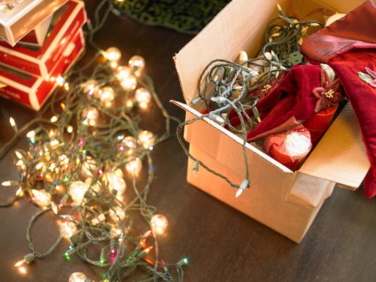 Christmas lights in boxes on floor