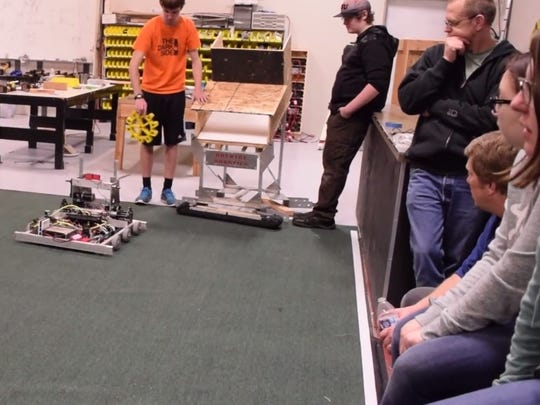 "Hotwire Robotics members move gears with its prototype robot as early preparations begin for its FIRST Robotics ""Steamworks"" challenge."