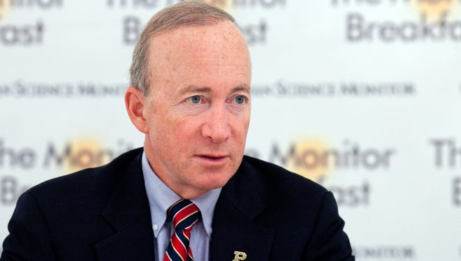 Purdue University President Mitch Daniels (shown at a breakfast hosted by the Christian Science Monitor on Oct. 3, 2013) is in Washington this week to discuss higher education issues.