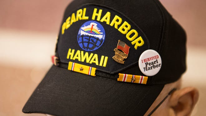 """Pearl Harbor veteran, 92-year-old Charles Hocker wears a Pearl Harbor hat as he arrives at the Louisville airport Thursday morning to begin his flight to Washington D.C. Hooker will be a Grand Marshall in the parade events remembering those that served and were lost in the attack that prompted America to join WWII. Hocker has wanted to go see the memorials and return to Pearl Harbor for 75 years. """"It's everything to me, or I wouldn't be struggling to go. I had a hard time even getting in the car to get out here,"""" Hocker said with a laugh. """"All the honor bestowed on me I'll pass it on to all my friends that were in the service with me. Some of them came back. Some didn't."""" Dec. 1, 2016"""