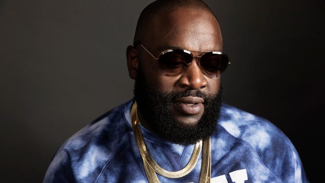 """Rick Ross posing for a portrait at Def Jam In New York in promotion of his album """"Hood Billionaire,"""" released on Monday, Nov. 24."""