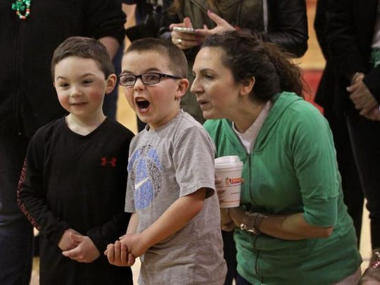Derek Grasso,5, center, seems stunned to see people