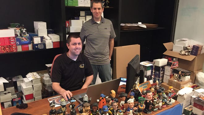 Phil Sklar (standing) and Brad Novak are trying to establish the National Bobblehead Hall of Fame and Museum in Milwaukee. They have more than 6,000 bobbleheads in their collection, many donated by fans.