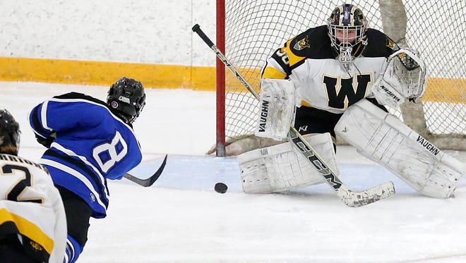 St. Mary's Springs' Zach Welsch takes a shot on goal at Waupun's Caleb Sauer during a Dec. 5 game.