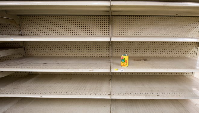 A single can remains on a shelf at Wetzel's Market Sunday during the last day of operation. All items were 50 percent off Sunday on the last day of operation.