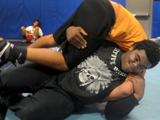 Buena High School wrestler Elijah Jackson-Clark, 17, practice his wrestling moves against his teammate Leo Martinez. Jackson-Clark worked hard in the offseason and that is reflected in a 25-0 record so far this season.