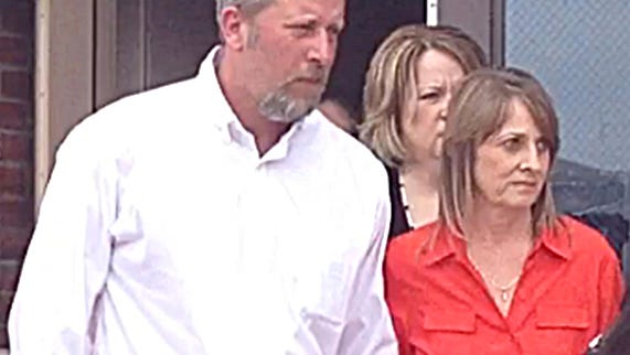David and Kim Hodgin, of Dickson County, leave the county juvenile courtroom earlier this year.