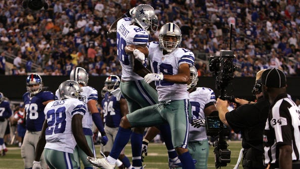 Cowboys wide receiver Miles Austin (19, facing) celebrates