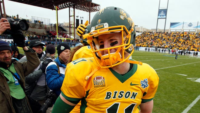 North Dakota State Bison quarterback Carson Wentz (11) reacts after the game against the Jacksonville State Gamecocks in the FCS Championship college football game at Toyota Stadium.
