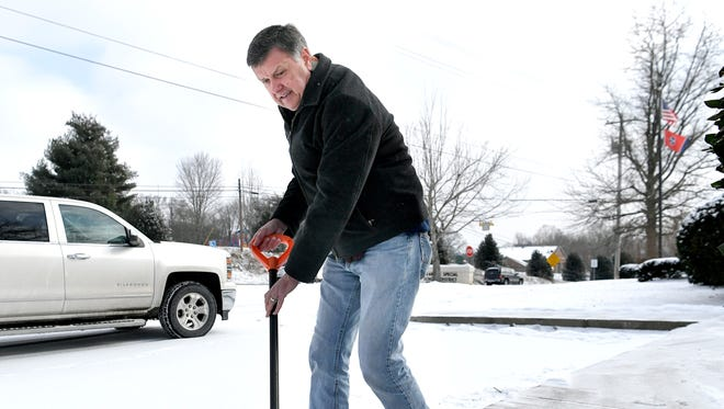 Franklin Special School District Director of Schools Dr. David Snowden shovels snow off the sidewalk at FSSD office in Franklin on Wednesday, Jan. 17, 2018. Franklin Special School District schools, administrative offices and MAC were closed on Wednesday.