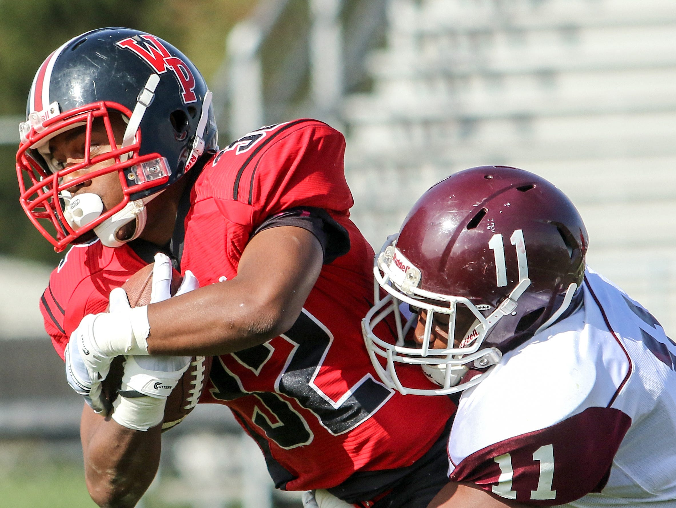William Penn's Joe Greenwood is wrapped up by Concord's Avery Roberts.