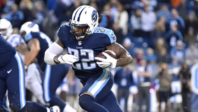 Titans running back Derrick Henry (22) gains yards late in the fourth quarter of the team's win over the Colts at Nissan Stadium Monday, Oct. 16, 2017 in Nashville, Tenn.