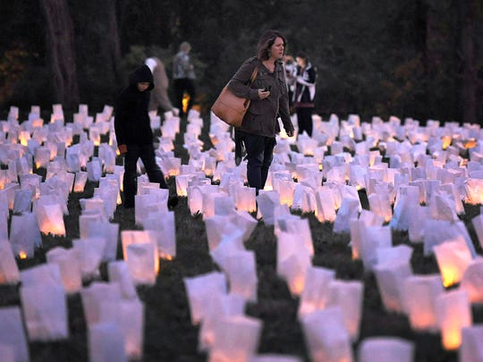 Each year on November 30th, The Battle of Franklin Trust hosts the annual Illumination where ten thousand luminaries are laid out to represent the 10,000 casualties from the Battle of Franklin in 1864. People walk among the luminaries at the Carter House on Thursday, Nov. 30, 2017.