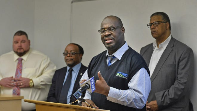 Shantel Hilliard, executive director of the Booker T. Washington Center in Erie, updates the media, March 17, 2020, on the plan to continue providing services through the center even though it is closed to the public by order of Gov. Tom Wolf to slow the spread of the coronavirus pandemic across Pennsylvania. Behind him, from left, are: Jeremy Peterson, executive director of the Erie Metropolitan Transit Authority, Gary Horton, executive director of the Quality of Life Learning Center, and the Rev. Charles Mock, pastor of Community Baptist Church in Erie.