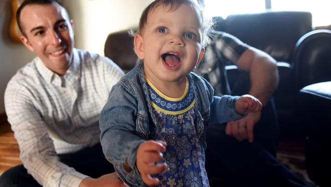Emmersyn Roling is all smiles while her dad, Larry Sandal, looks on at their home in Sioux Falls.