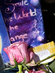 Items are left at a memorial for family members who