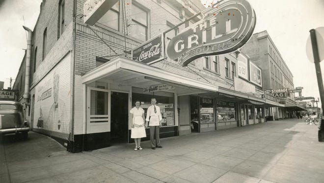 Lucille B. Howe Roller and Otto Roller are seen in front of their restaurant, The Grill, at 264 High St. in Salem in 1940. The area now houses the Salem's Transit Mall and the city's buses.