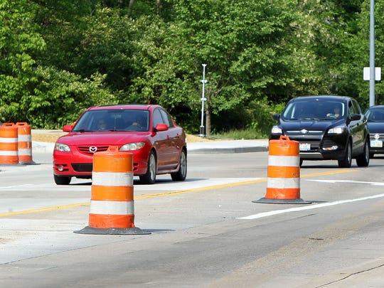 Orange barrels line Queen City Avenue in South Fairmount as the road undergoes extensive repair.