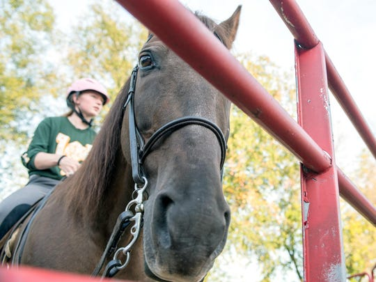 Pennfield senior Lacey White rides her horse JD during a recent equestrian practice.