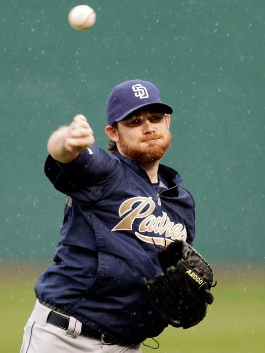 San Diego Padres starting pitcher Ian Kennedy throws in the rain at Progressive Field in Cleveland, Monday, April 7, 2014. The baseball game between the Padres and Cleveland Indians was postponed due to rain. (AP Photo/Mark Duncan)