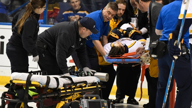\Predators center Kevin Fiala (56) is placed on a cart after injuring his leg during the second period in game 1 of the second round NHL Stanley Cup Playoffs at the Scottrade Center Wednesday, April 26, 2017, in St. Louis, Mo.