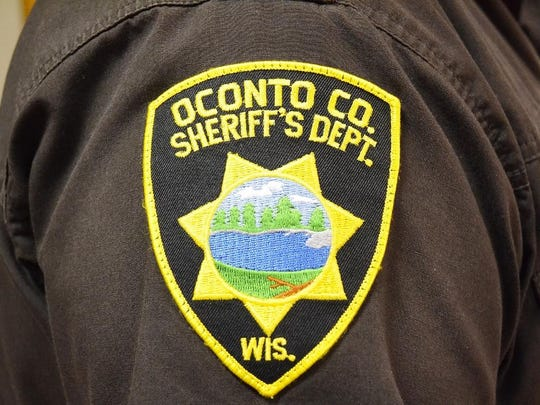 An Oconto County Sheriff's badge.