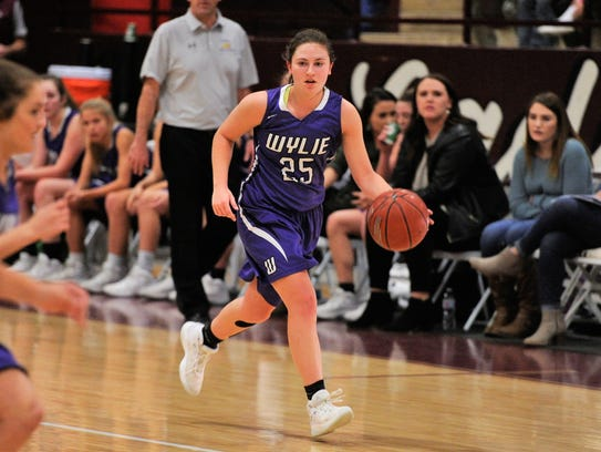 Wylie guard Lauren Fulenwider (25) brings the ball