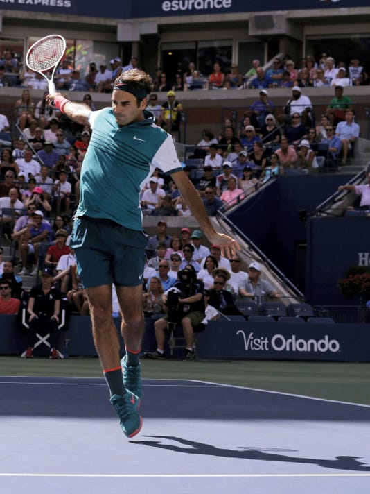 Roger Federer follows through on a shot to Philipp Kohlschreiber during the third round of the U.S. Open on Saturday in New York.