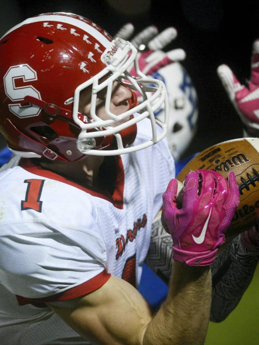 Susquehannock's Nick Tannura makes a catch through the coverage of Kennard-Dale's Jake Deppen during Friday's game at Kennard-Dale High School. Susquehannock won, 35-17.