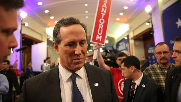 Rick Santorum visits the spin room after finishing