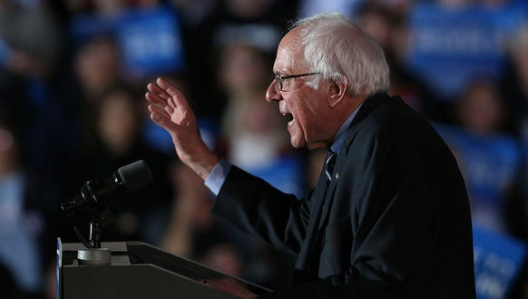 Bernie Sanders speaks on stage after declaring victory