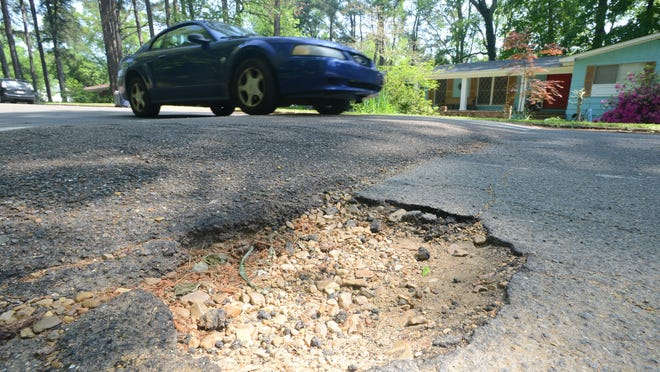 Potholes like this one along Briarwood Drive in Jackson are the target of an overall infrastructure master plan the city has unveiled.