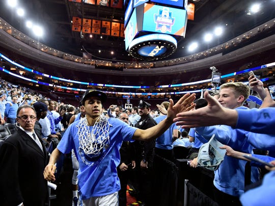 North Carolina Tar Heels guard Marcus Paige (5) celebrates after defeating the Notre Dame Fighting Irish in the championship game in the East regional of the NCAA Tournament at Wells Fargo Center in Philadelphia on March 27, 2016.