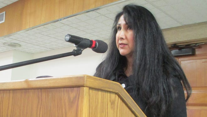 Terry Beltran, of Ask the Latina, speaks at Pontiac City Council meeting on March 16, 2017, asking them to pass resolution supporting immigrants.